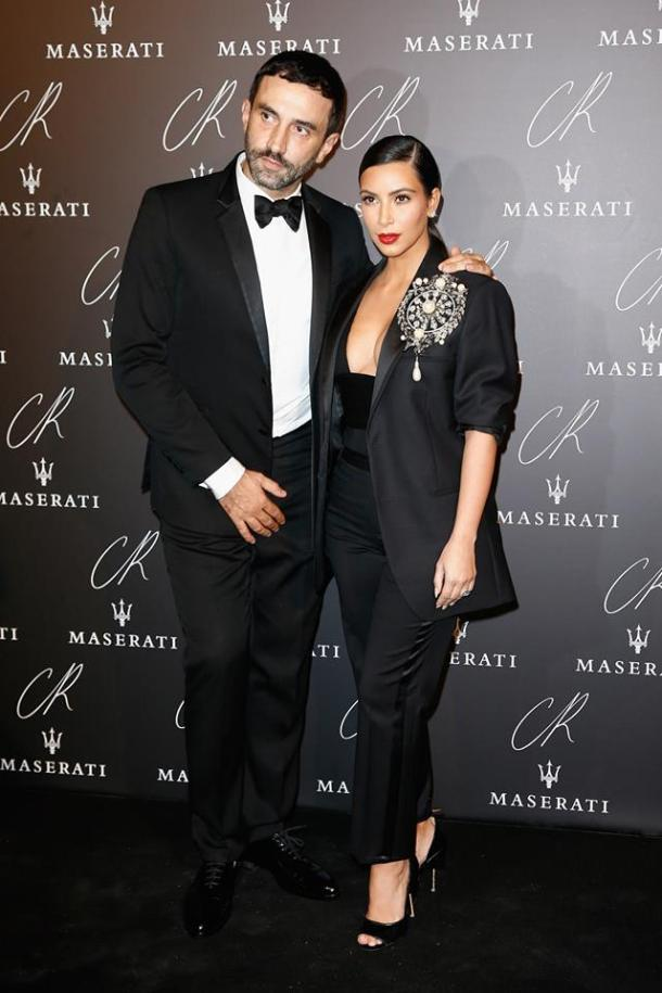 KIM KARDASHIAN, WITH RICCARDO TISCI, IN A GIVENCHY BY RICCARDO TISCI SPRING-SUMMER 2015 OUTFIT TO THE CR FASHION BOOK ISSUE 5 LAUNCH PARTY HOSTED BY CARINE ROITFELD & STEPHEN GAN