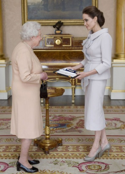 The actress and humanitarian opted for a dove grey skirt suit by British couture house Ralph & Russo to pick up the award for services to UK foreign policy and her campaigning to end sexual violence in war zones.