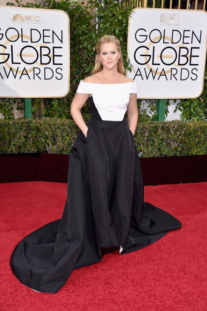 """Funnywoman Amy Schumer, who has been nominated for Best Actress in a Musical/Comedy in """"Trainwreck,"""" kept things classy in a monochrome Prabal Gurung gown at the 73rd Annual Golden Globe Awards on Jan. 10, 2016."""