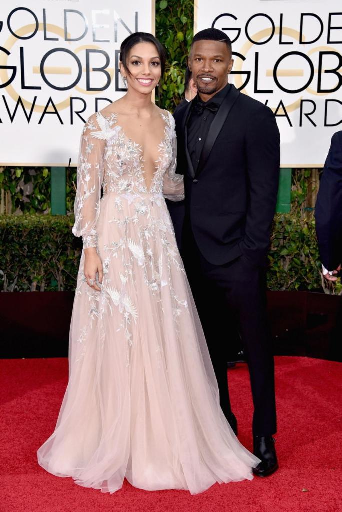 Miss Golden Globes 2016, Corinne Bishop (L) and actor Jamie Foxx attend the 73rd Annual Golden Globe Awards held at the Beverly Hilton Hotel on January 10, 2016 in Beverly Hills, California.