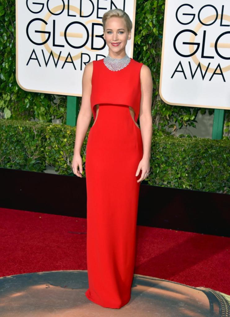 """Jennifer Lawrence, who took home the award for best actress for her film """"Joy,"""" looked red hot in a striking cut-out Dior gown at the 73rd annual Golden Globe Awards on Jan. 10, 2016."""