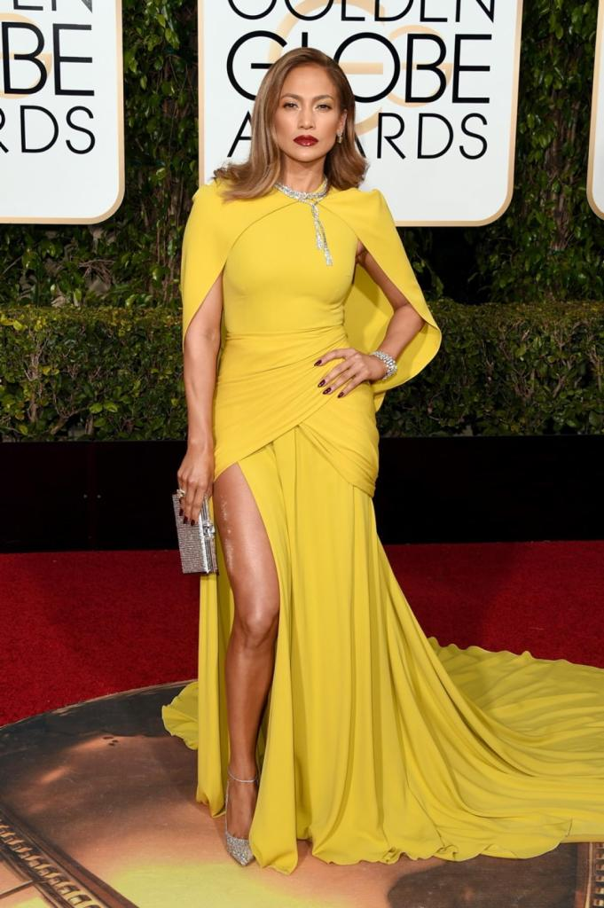 Leave it to Jennifer Lopez to make a bold statement on the Golden Globes red carpet. The superstar turned heads in a striking yellow Giambattista Valli gown that featured a cape, completing the look with 200 carats worth of Harry Winston diamonds at the 2016 Golden Globes on Jan. 10, 2016.