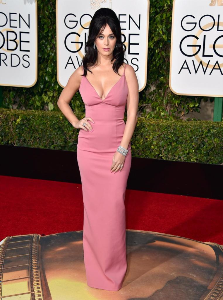 Katy Perry looked like she'd walked straight out of the 60s, donning a bump-it in her hair, teamed with a cleavage-baring pink Prada gown at the 73rd annual Golden Globe Awards on Jan. 10, 2016.