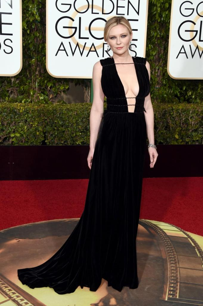 """Actress Kirsten Dunst showed off her assets in a plunging Valentino gown at the 73rd Annual Golden Globe Awards on Jan. 10, 2016. The 33-year-old actress was nominated for Best Actress in a Limited Series for her role in """"Fargo,"""" but lost out to Lady Gaga."""