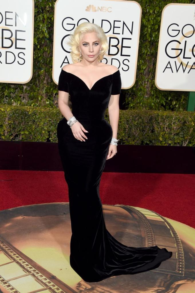 """There's nothing Gaga about this look! Lady Gaga oozed old Hollywood glamour in a stunning velvet Atelier Versace gown at the 73rd Annual Golden Globe Awards on Jan. 10, 2016. The 29-year-old entertainer won the award for Best Performance by an Actress in a Mini-Series or a Motion Picture Made for Television for her work on the series """"American Horror Story: Hotel,"""" her first nomination and win as an actress."""