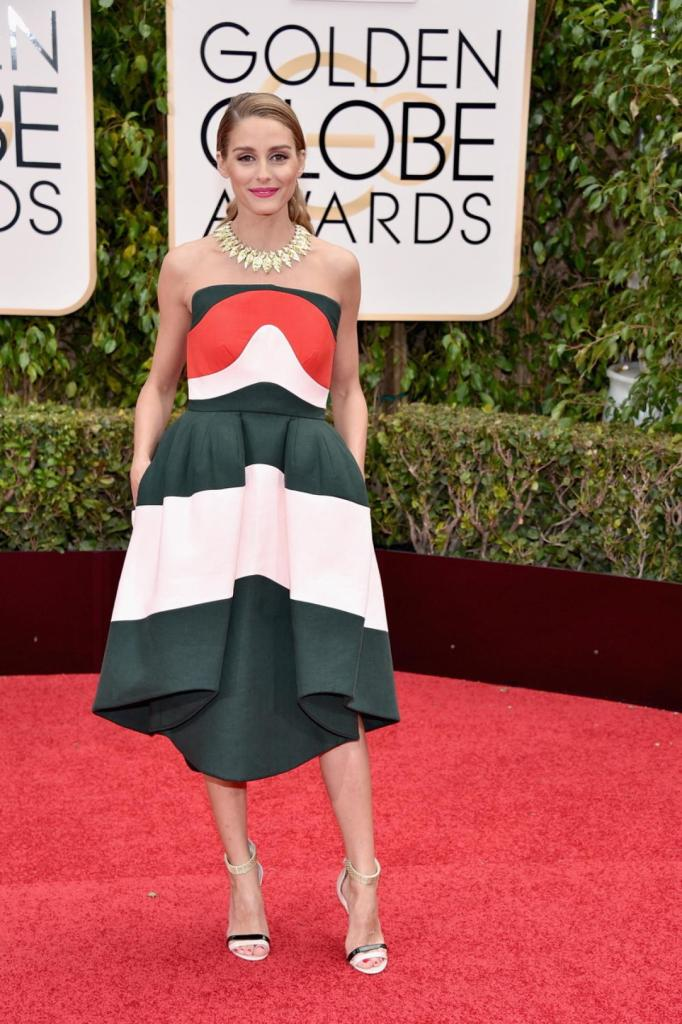 """Socialite Olivia Palermo, known for her role in """"The City,"""" opted for a color block Delpozo dress of green, red and white as she arrived to the 73rd Annual Golden Globe Awards on Jan. 10, 2016."""