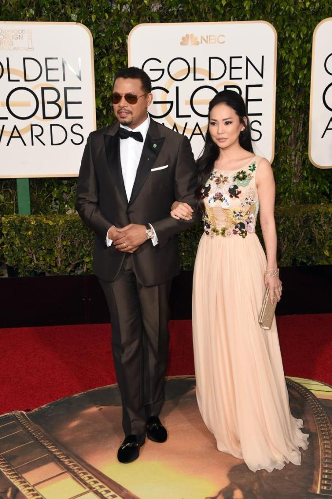 """""""Empire"""" star Terrence Howard and wife Mira Pak on the Golden Globes red carpet in Beverly Hills, California, on Jan. 10, 2016."""