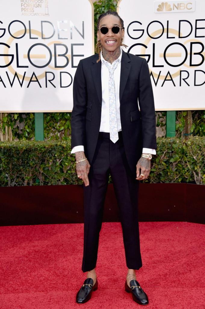 """Forget about Tom Ford, recording artist Wiz Khalifa rocked a Thom Browne suit the Golden Globes. The 22-year-old, who is nominated for Best Original Song for """"See You Again"""" from Furious 7 clearly had a lot to smile about on the red carpet."""